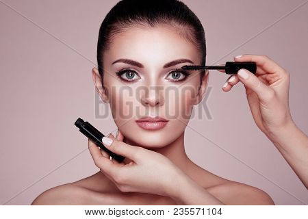 Beautiful Brunette Woman Paints The Eyelashes. Beautiful Woman Face. Makeup Detail. Beauty Girl With