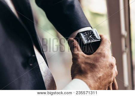 A Stylish Mechanical Watch On The Arm Of A Man Dressed In A Blue Jacket With A White Shirt That Watc