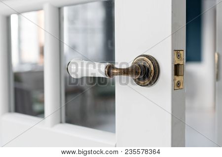 Beautiful Modern Door Knob. Open, Wooden Front Door From The Interior Of An Upscale Home With Window