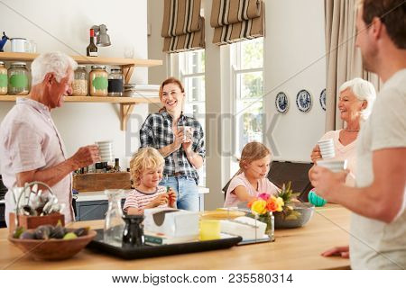 Multi generation family talking at home in their kitchen
