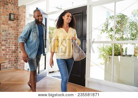 Young mixed race couple arriving at home