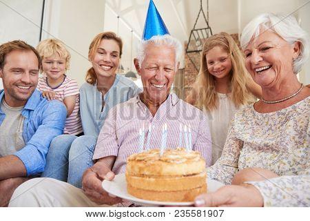 Multi generation family celebrating grandadÕs birthday