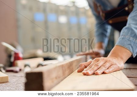 Carpenter Working On Woodworking Machines In Carpentry Shop. Woman Works In A Carpentry Shop.
