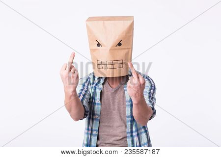 Man With Cardboard Box On His Head And Drawing Of Angry Emoticon Face. Angry Man Starting A Fight