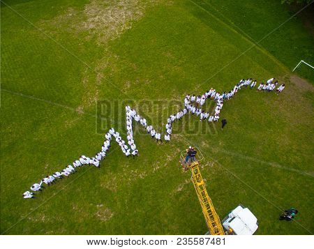 Ivano-frankivsk, Ukraine - 22 April 2018: Medical Students Standing On The Grass, Making Live Heart