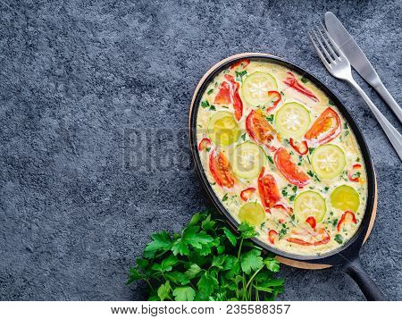 Scrambled Eggs  With Mix Of Colorful Vegetables.  Beautiful Appetizing Dinner. Top View, Close-up, D