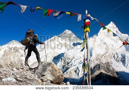 View Of Mount Everest With Tourist And Buddhist Prayer Flags From Kala Patthar And Blue Sky - Way To