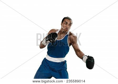 Sporty Man During Boxing Exercises Making Hit. Photo Of Boxer On White Background. Strength, Attack