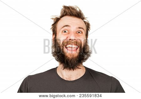 Young Funny Guy With Beard Laughs. Isolated On White.