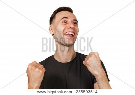 Young Happy Smiling Man With Clenched Fists, Looking Up, Isolated On White.