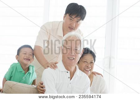 Portrait of happy Asian family at home, multi generations people indoor lifestyle.