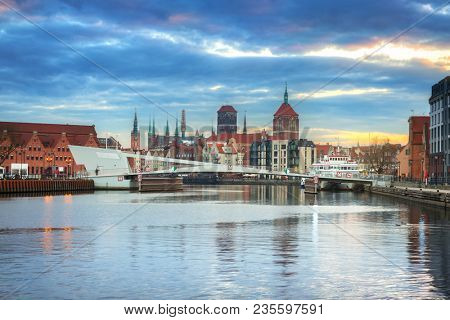 Old town of Gdansk reflected in Motlawa river at sunset, Poland