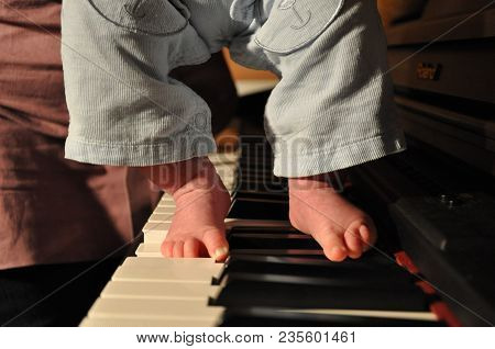Fingers Playing Keyboard Piano, Toes Of Small Baby
