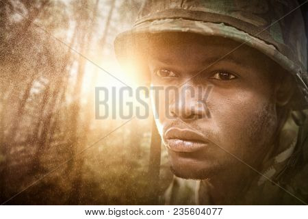 Composite image of close up of military soldier
