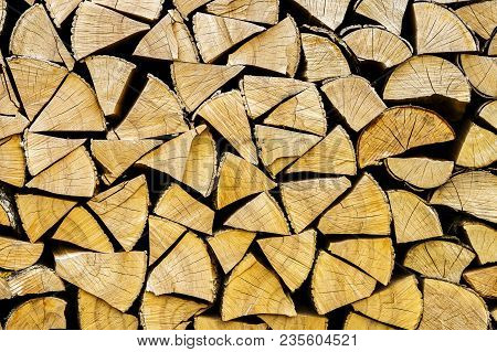 Chopped Logs For Winter Fire. Pile Of Chopped Fire Wood Prepared For Winter. Chopped Firewood Textur