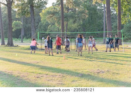 Group Of Multiethnic People Playing Outdoor Volleyball In Summer Park