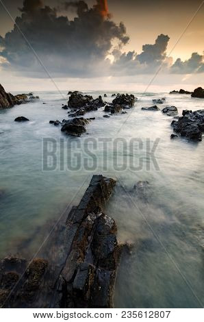 Scenery Of Pandak Beach Located In Terengganu,malaysia During Sunrise With Its Unique Rock Formation