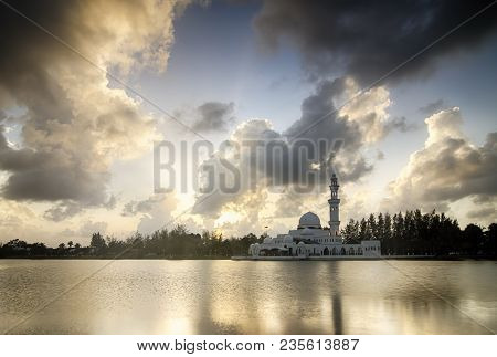 Beautiful White  Mosque Near The Lakeside During Sunset. Soft Cloud And Reflection. Image Taken At T