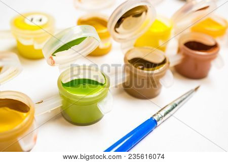 In Plastic Containers Is A Different Color Paint For Artist Drawing, Tassel