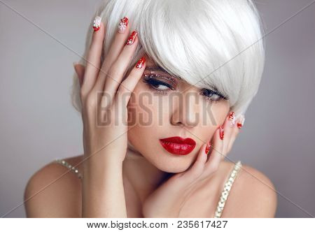 Christmas Makeup. Red Lips Makeup. Beautiful Blonde Girl Closeup Portrait. Manicured Nails. White Sh