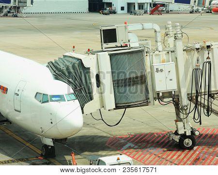 Passenger Boarding Bridge Connecting To An Air Plane