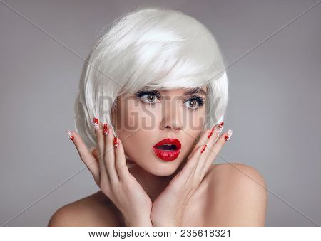 Shocked Face. Blond Woman With Red Lips And Manicure Nails Surprise Holds Cheeks By Hand. Beautiful