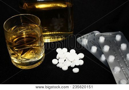 Drugs, Blister, Glass And Bottle Of Alcohol. Benzodiazepines Suicide Combination Or Addiction Narcot
