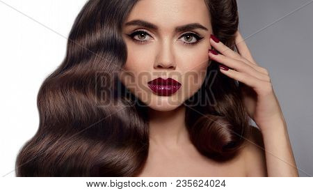 Beauty Makeup. Glamour Woman Face Close Up. Manicured Nails. Healthy Shiny Hairstyle. Fashion Shiny