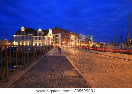 Promenade at Motlawa river in Gdansk at night, Poland