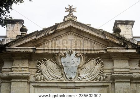 Stone Carved Coat Of Arms And Maltese Cross Above The Entrance Of The Knights Hospitallers Church, V