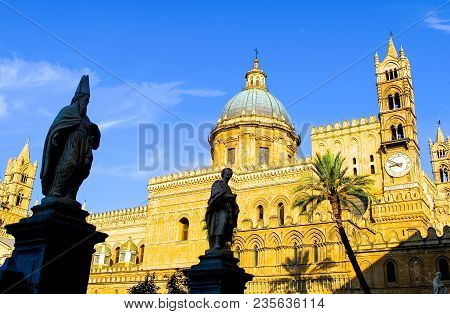 Italy, Sicily, Palermo, View Of The Facade Of The Cathedral With Backlight Statues In The Foreground