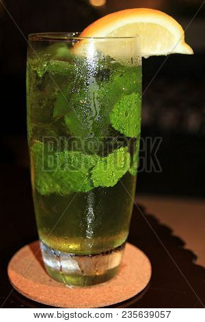 Glass Of Cold Water, With Mint Fresh Leaves And Slice Of Orange A Glass Of Cold Water With Fresh Min