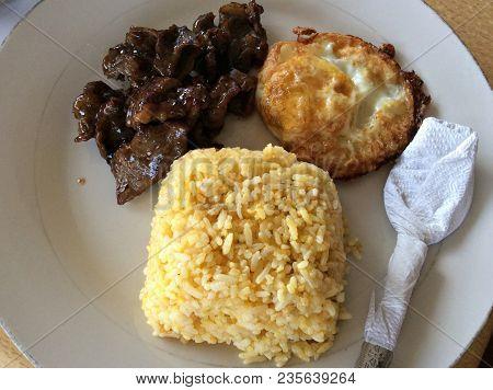Tapsilog- Favorite Filipino Budget Meal Tapsilog Which Is Short For Tapa (cured Beef), Sinangag (fri