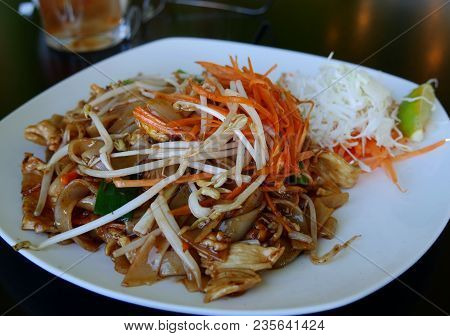 Chicken Pad Thai Dish Served On A White