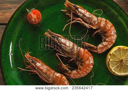 Grilled Shrimps With Lemon On Green Plate Background, Copy Space. Top View On Appetizing Seafood Sna