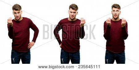 Handsome blond man angry gesturing typical italian gesture with hand, looking to camera isolated over white background