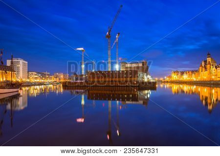 Island with building construction at Motlawa river, Gdansk