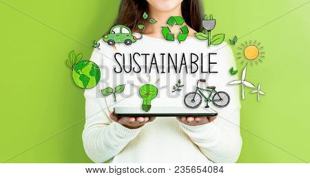 Sustainable With Woman Holding A Tablet Computer