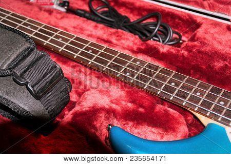 Four-string Bass Guitar In Case. Selective Focus