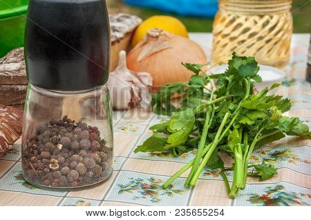 Still Life Outdoors With Fresh Vegetables And Black Pepper Peas In A Mill