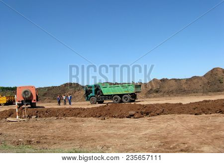 Road Working On The New Road Construction Site. Highway Road Works Construction Build Machinery Dump