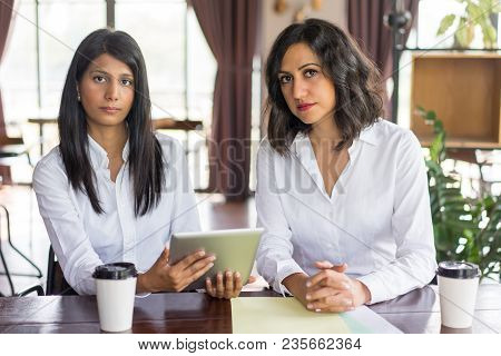 Portrait Of Confident Multiethnic Female Colleagues With Digital Tablet. Young Caucasian And Latin A