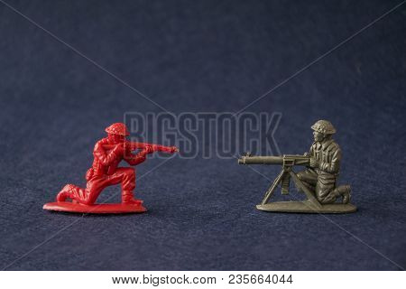Miniature Toy Soldiers Fighting. Red And Green Plastic Toy Military Men Models Attack At War.