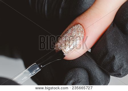 Manicure. Master Applies Varnish Drawing On Nails Gel In Manicure Salon.
