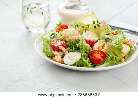 Fresh Salad Of Lettuce. Shrimp, Tomatoes And Quail Eggs With Dressing Alioli