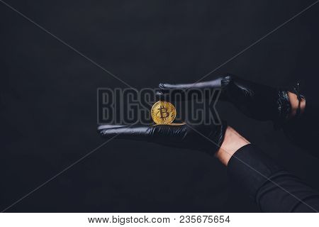 Bitcoins Are Placed On The Arm Black