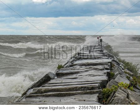 Very Windy Day On Lake Erie As Waves Splash Over This Groin.
