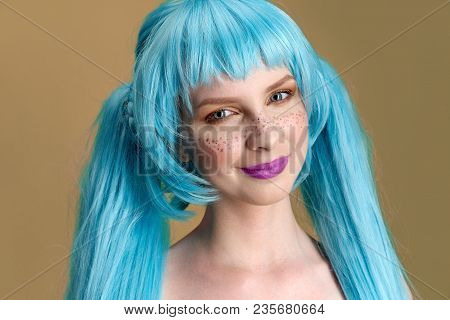 Large Detailed Studio Portrait Of A Young Stylish Woman With Long Blue Hair And Freckles With Positi