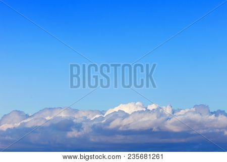 blue sky above the Cumulus clouds. Background image poster