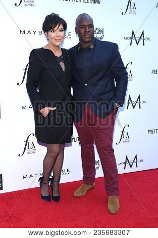 LOS ANGELES - APR 08:  Kris Jenner and Corey Gamble arrives to the Daily Front Row Fashion Awards  on April 8, 2018 in Beverly Hills, CA